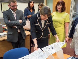 First Minister of Northern Ireland Arlene FOSTER MLA inspects ephemera, Northern Ireland Political Collection. Divided Society digitisation project launch. Linen Hall Library, Belfast, Northern Ireland. @TheLinenHall
